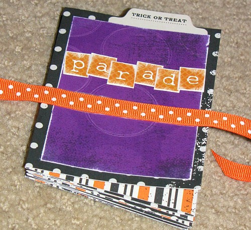 Halloween Mini Album - Such a cute way to display Halloween photos and record memories throughout the years!  // cleanandscentsible.com