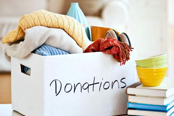 How to get organized. Donation box filled with household items to donate.