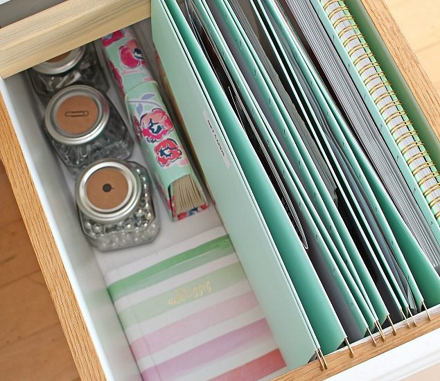 Drawer with file folders added to keep paper clutter under control.