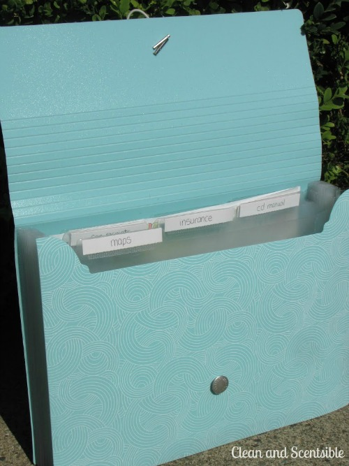 Use a file folder in the car to hold insurance papers, maps, car related receipts coupons, etc.