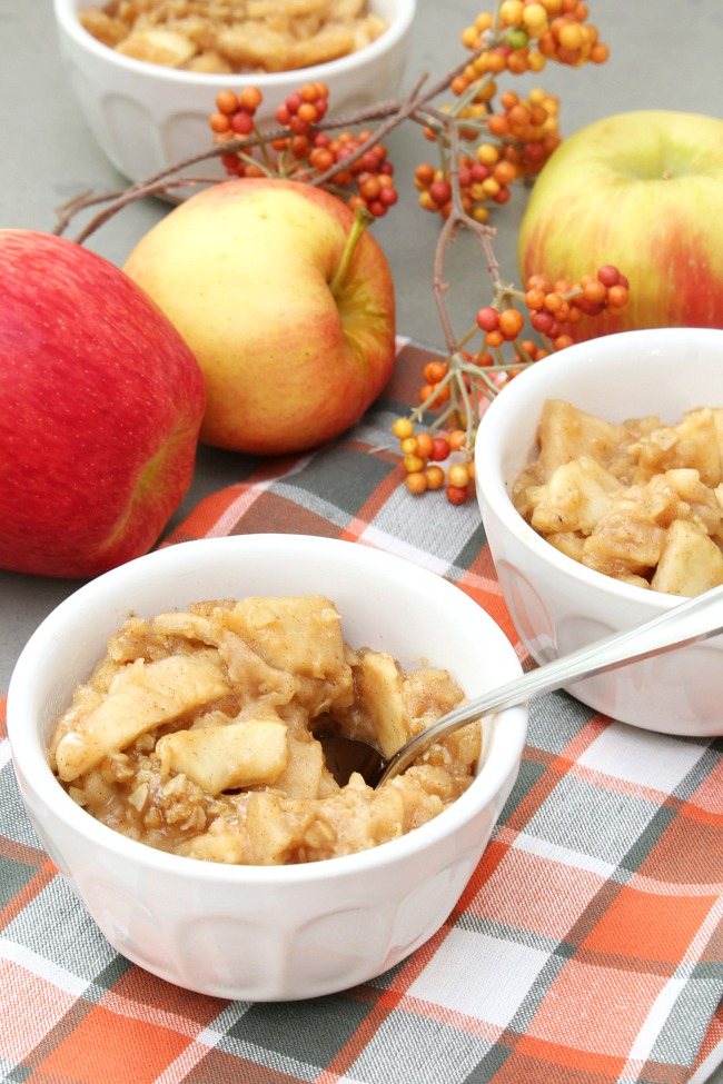Bowls of apple crisp made in the slow cooker.
