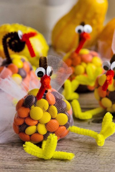 Candy filled turkey treats for Thanksgiving using M&Ms, pipe cleaners, and tulle.
