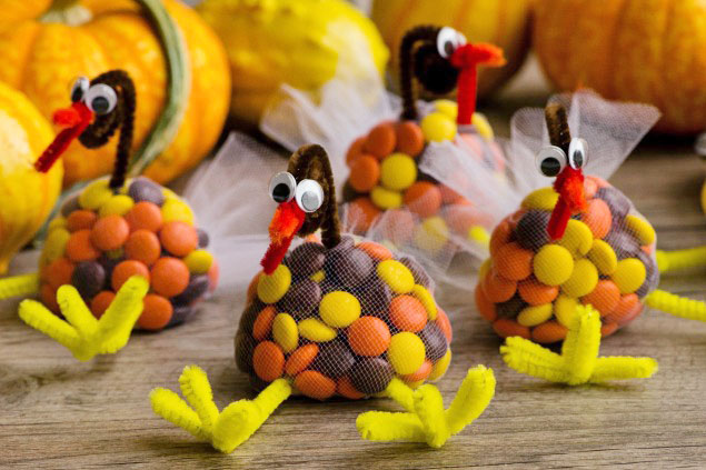 Cute Thanksgiving craft idea with candy turkey treats made from M&Ms, tulle, and pipecleaners.