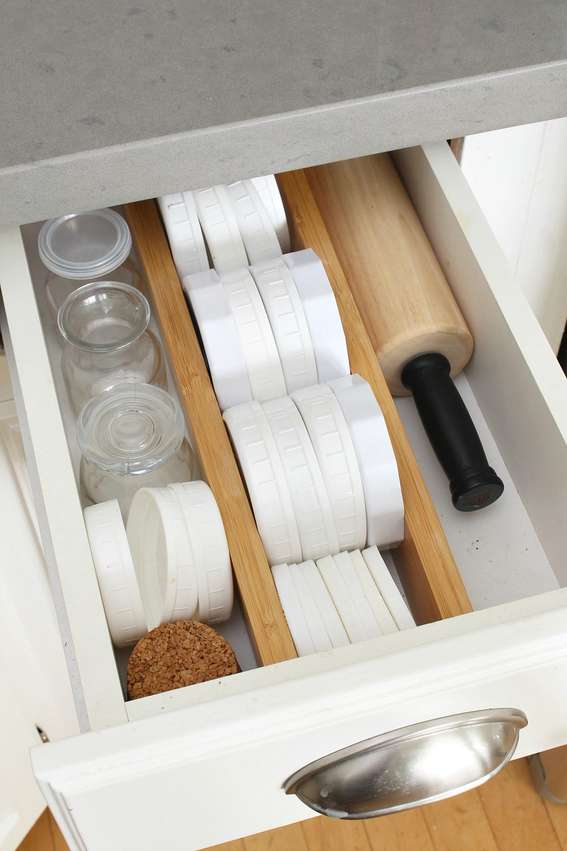 Organized kitchen drawer with adjustable bamboo drawer dividers.