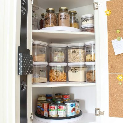 OXO airtight food storage containers in a corner lazy susan cabinet.
