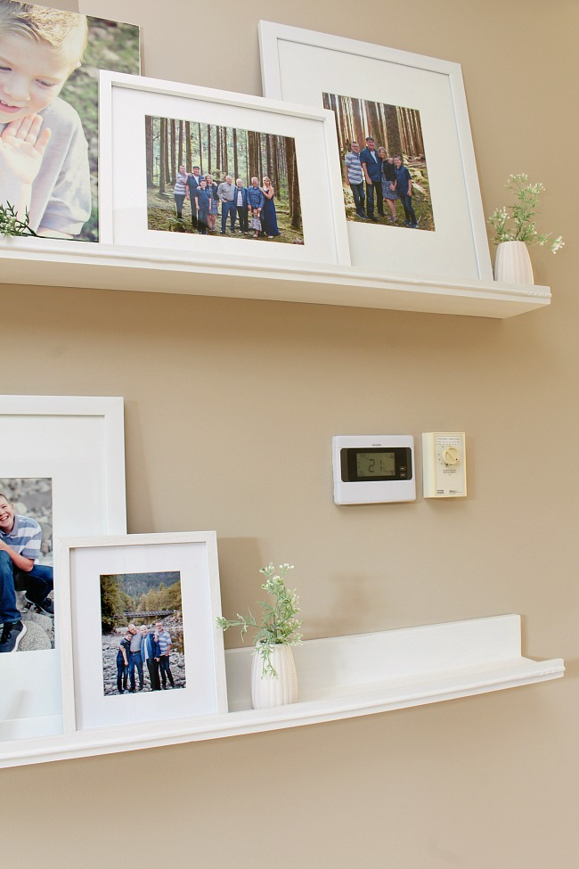 Photo ledges with a canvas photo to cover up an ugly thermostat and alarm panel.