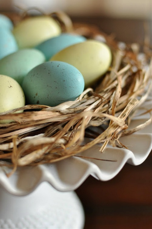 Pretty, naturally colored Easter eggs displayed in a nest.