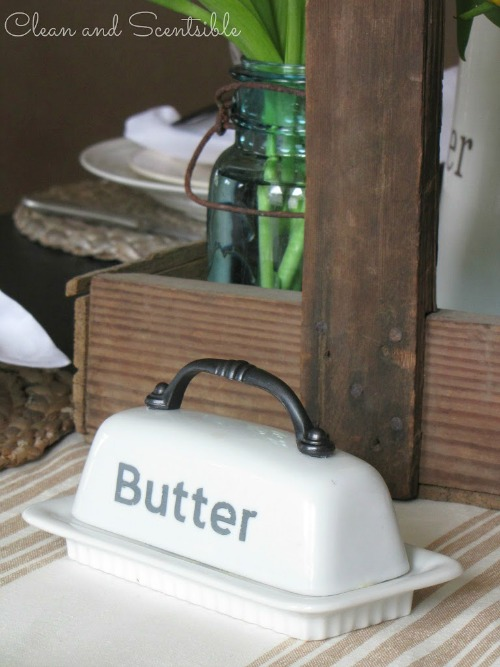 Pretty and rustic spring tablescape.  This butter dish is so cute!