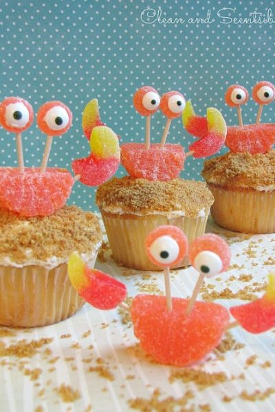 "Cute crab cupcakes with graham cracker ""sand"" and gummy ""crabs""."