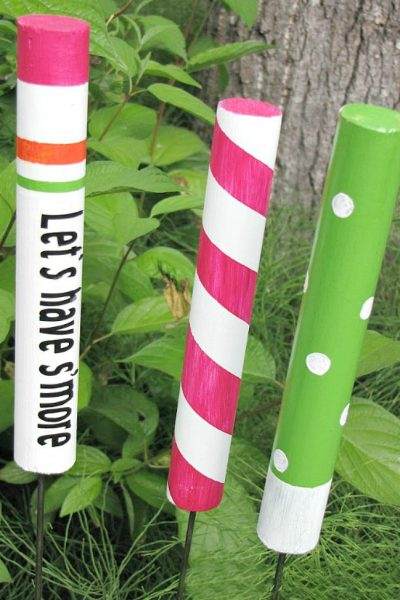 Custom DIY campfire roasting sticks with painted wood dowels.