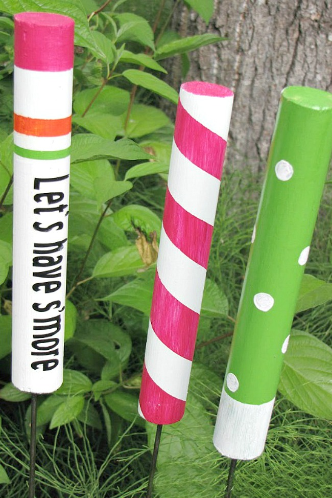 Custom DIY marshmallow roasting sticks with painted wood dowels.
