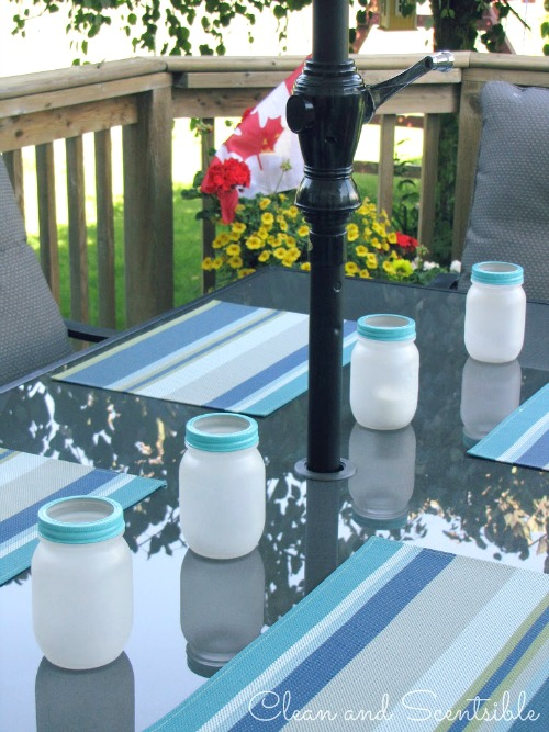 Frosted Mason jars with tea lights for patio lighting.