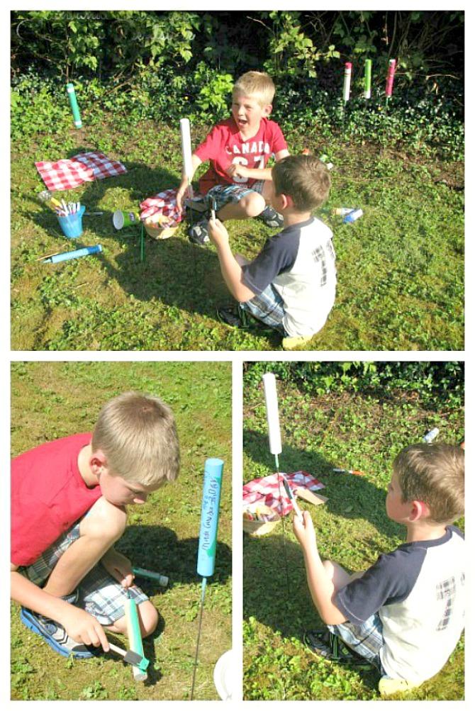 Kids making DIY custom roasting sticks by painting wood dowels.