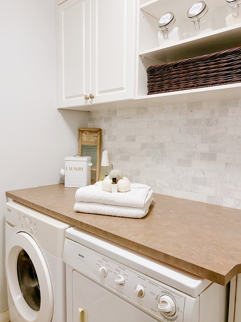 Laundry room with under the counter washer and dryer.