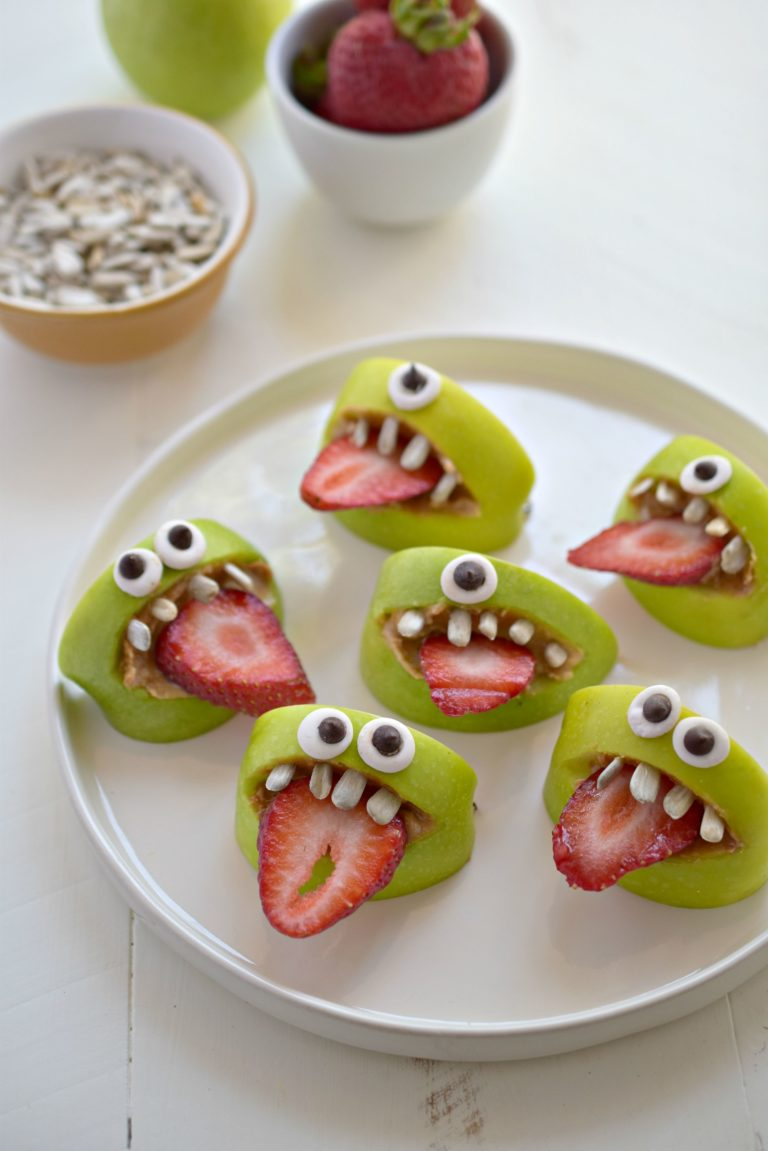 Apple Bite Monsters using apples, candy eyes, and strawberries.