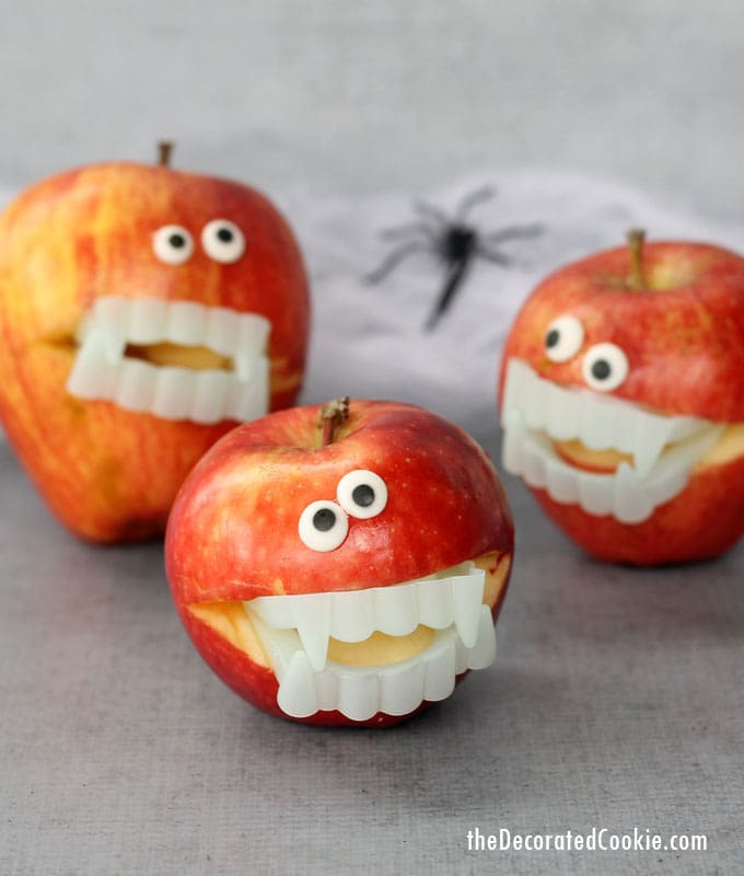 Healthy Halloween snack ideas. Apple monsters using candy eyes and pastic vampire teeth.
