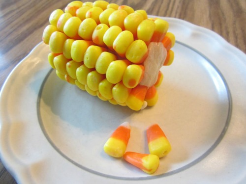 Candy corn corn-on-the-cob.  Lots of other fun candy corn ideas too!