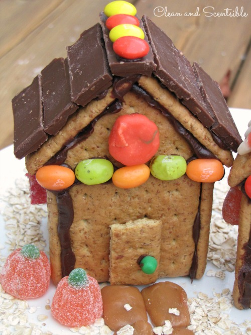Thanksgiving or fall house made from graham crackers and left over Halloween candy - great way to use up that candy stash!