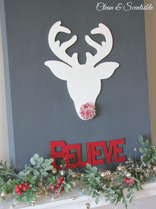 Believe Christmas canvas with reindeer and pom pom nose.