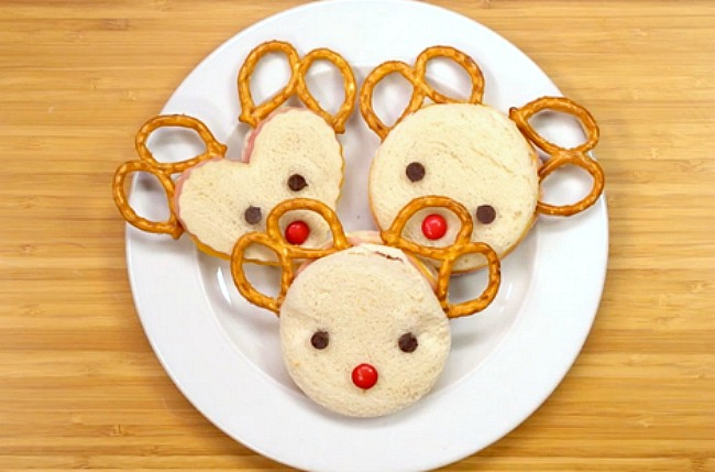 Reindeer sandwiches using a round cookie cutter and pretzels.