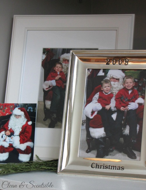 Christmas Mantel - yearly Santa photos.
