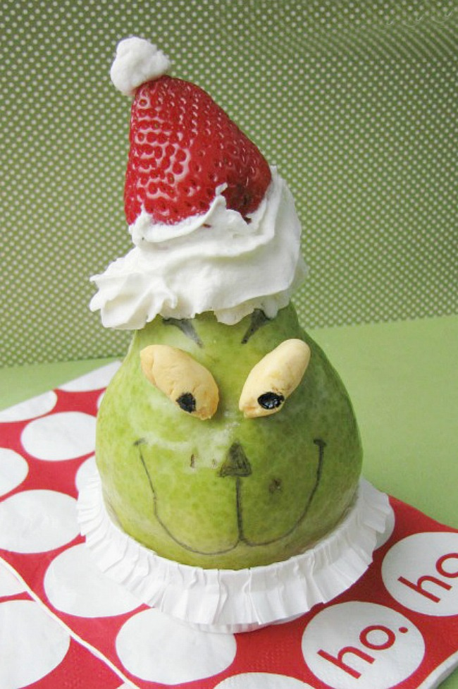 Healthy Grinch snack made from a pear and a strawberry.