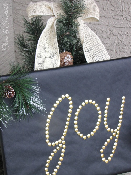 Quick and easy Joy sign made from Styrofoam and thumb tacks.