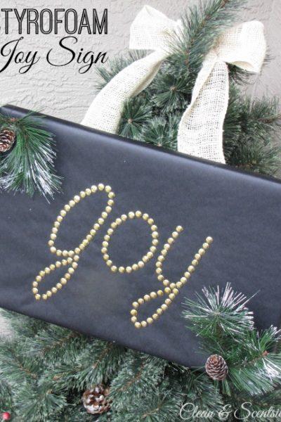 Joy sign made from Styrofoam and thumb tacks.