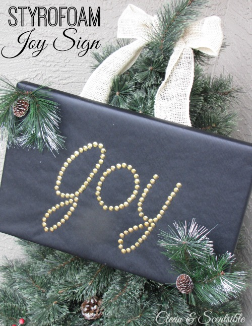 Joy sign made from Styrofoam and thumb tacks.