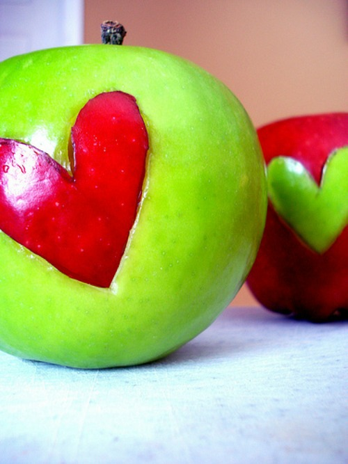 Apples with cut out hearts for a healthy Valentines's Day snack.