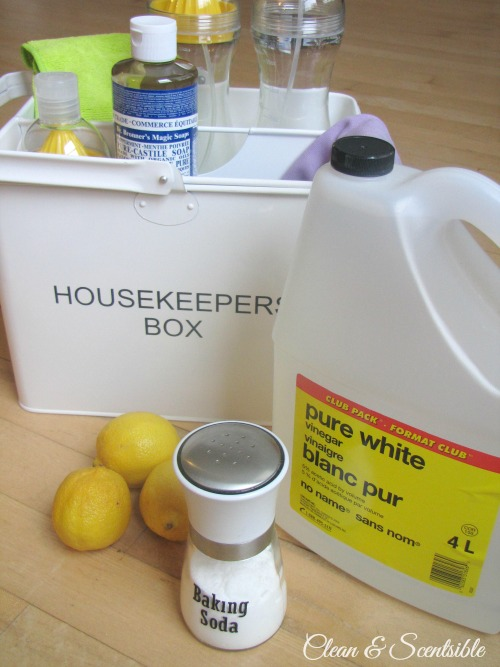 Green cleaning supplies for cleaning the bathroom.