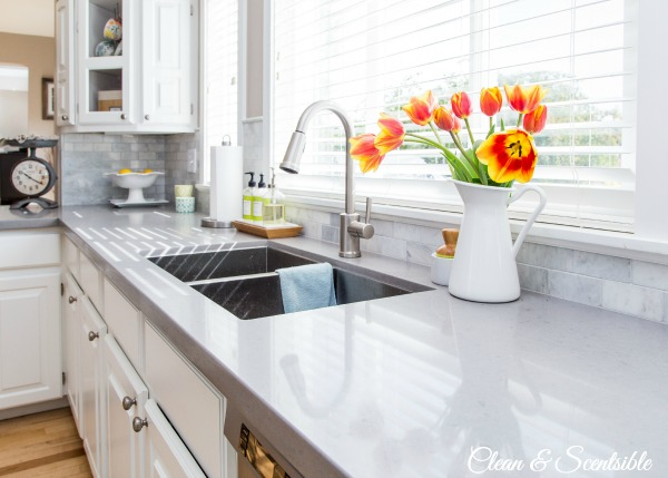 Beautiful white kitchen with quartz countertops.