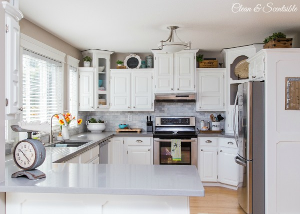 Beautiful white kitchen with grey quartz countertops.