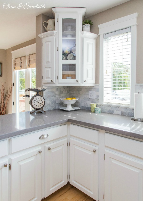 Beautiful white kitchen with grey quartz countertops.