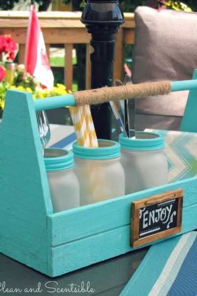 Cute picnic caddy with frosted mason jars. Could be used as a utensil holder, candle holder, planter, and more!