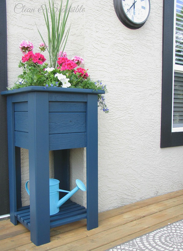 Wooden planter makeover using Behr Premium Solid Color Weather Proofing in Atlantic.