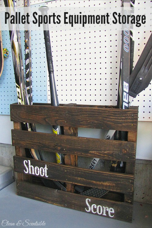 Turn an old pallet into functional storage for hockey sticks, baseball bats, and other items! // cleanandscentsible.com