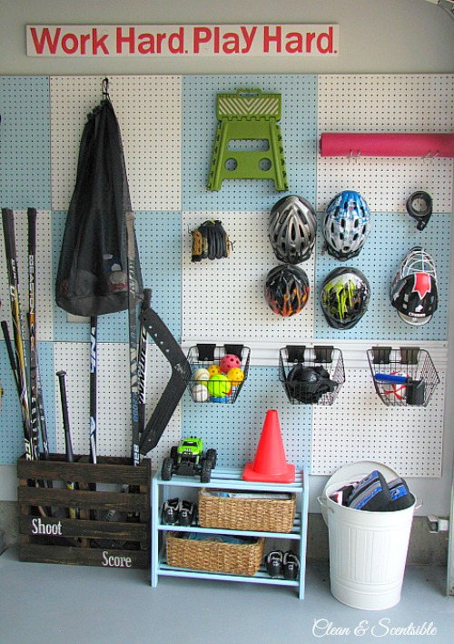 Love this pegboard organizer for organizing sports equipment! // cleanandscentsible.com