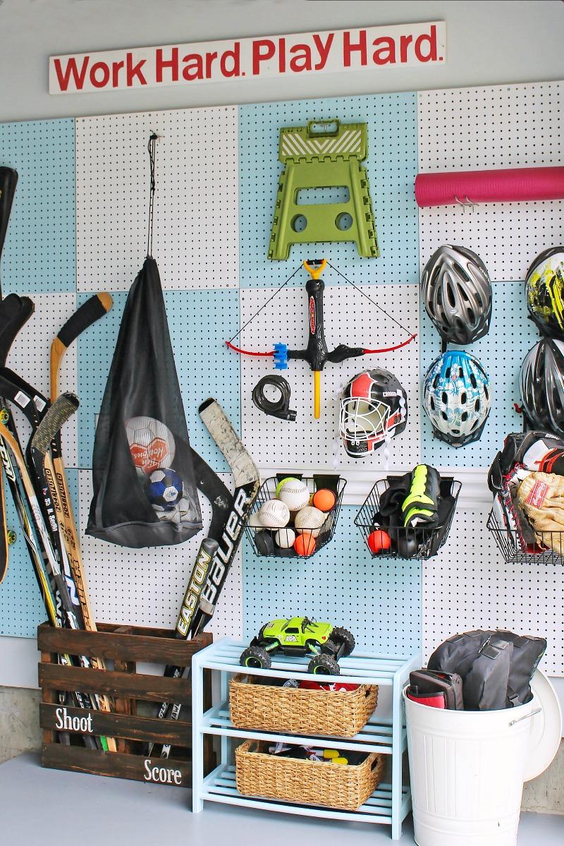 Pegboard wall organizer for sports equipment.