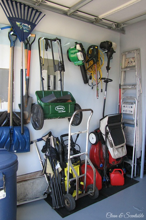 Organized garage space for yard equipment.