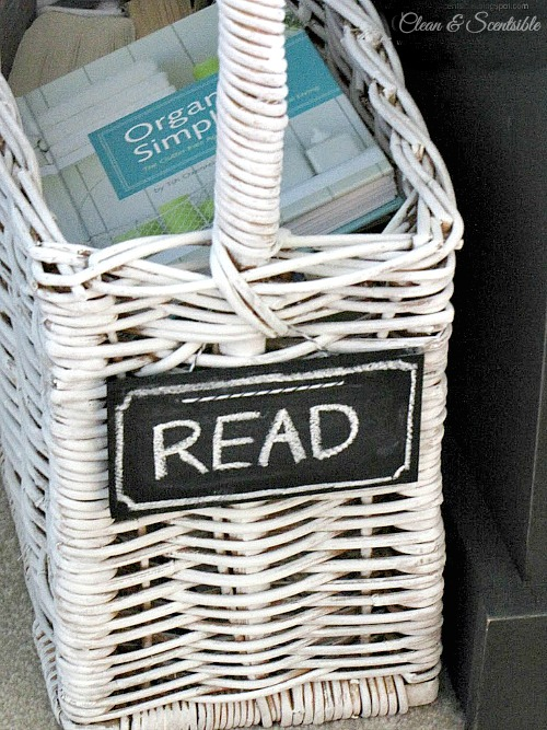 Cute book basket to organize books and magazines at bedside.