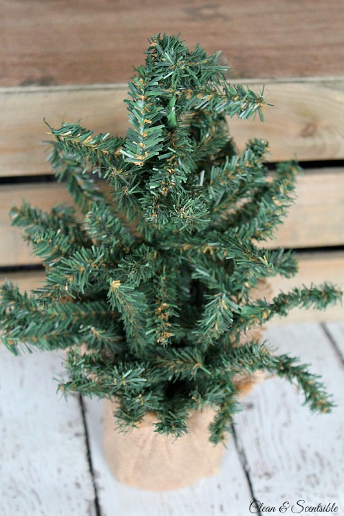 Transform a plain, inexpensive tree into a pretty snow covered tree with glittered pine cones. // cleanandscentsible.com