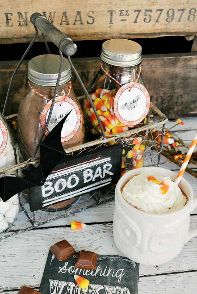 Cute little Halloween hot chocolate bar with milk bottles in a wire crate.