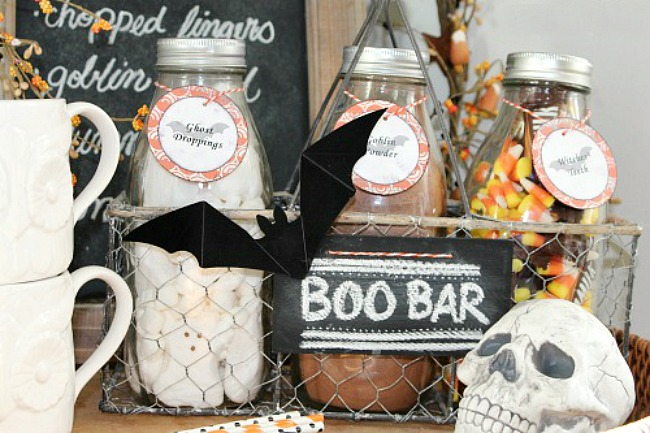 Halloween beverage bar with milk bottles in a crate.