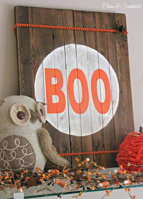 "Rustic Halloween sign made from garden stakes with ""Boo""."