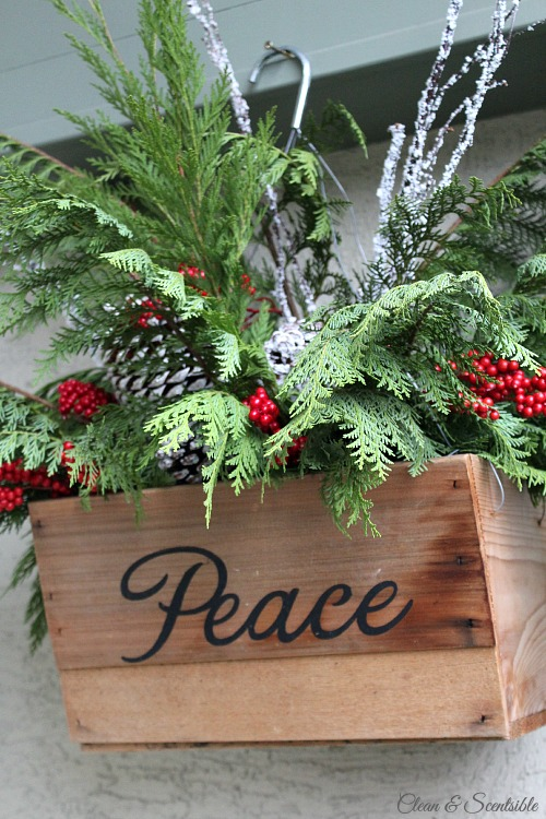 Beautiful Christmas home tour.  Love these hanging baskets for the front porch! // cleanandscentsible.com
