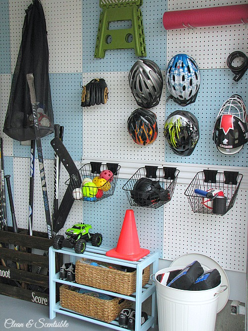 Love this pegboard wall to organize sports equipment!  // cleanandscentsible.com