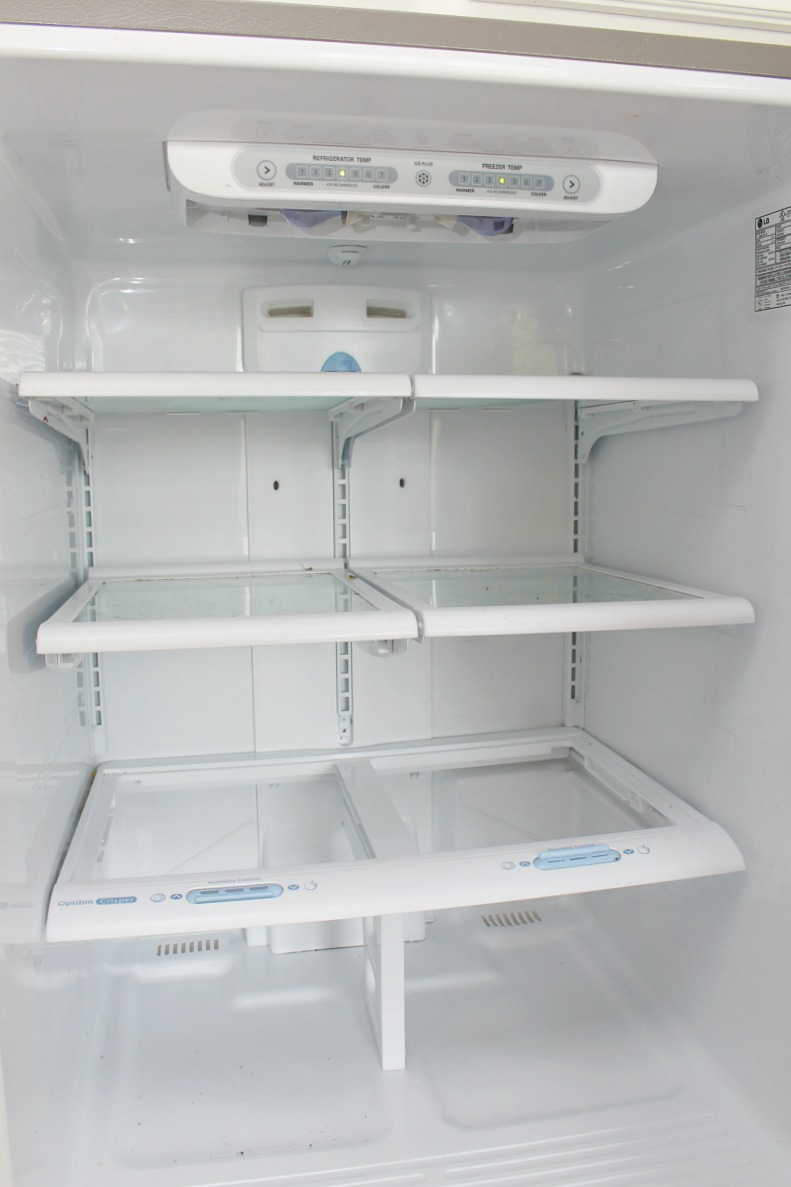 Clean and empty fridge space.