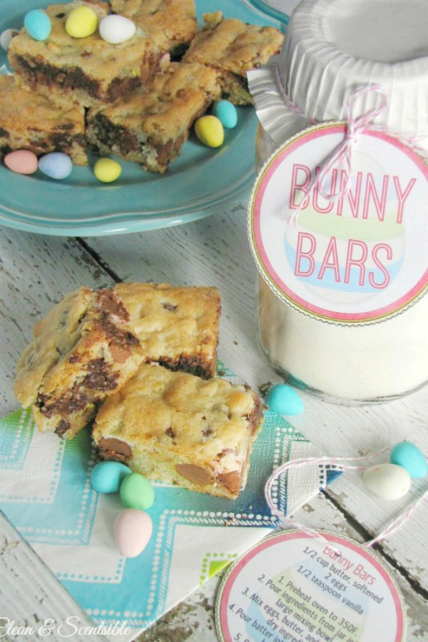 Delicious mini egg dessert bars on a pretty Easter plate along with an Easter gift hostess gift of the Bunny Bars ingredients in a mason jar.