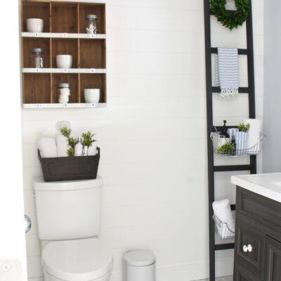 DIY storage ladder in a farmhouse style bathroom.
